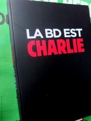 La BD est Charlie-Couv-PhotosLP Fallot.JPG